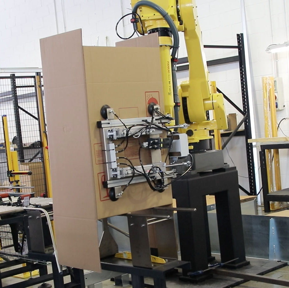 Robot formador de cajas automático con garraa de ventosas