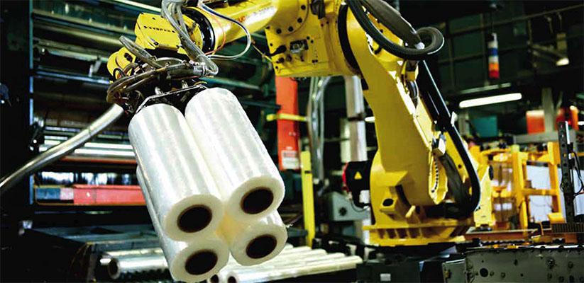 Detalle de robot de carga de rollos de film retráctil